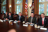 United States President George W. Bush meets with Members of the Commission on the Intelligence Capabilities of the United States Regarding Weapons of Mass Destruction in the Cabinet Room at the White House in Washington, D.C. on March 31, 2005. From left to right: National Security Advisor Steven Hadley; former United States Senator Chuck Robb (Democrat of Virginia), Co-Chairman; President Bush; Judge Laurence Silberman, Co-Chairman; and White House Chief of Staff Andrew Card.<br /> Credit: Ron Sachs / CNP