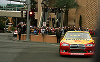 Kurt Busch drives the #22 Pennzoil Dodge down Las Vegas Blvd during the NASCAR victory lap, Las Vegas, NV, December 1, 2011.  (Photo by Brian Cleary/www.bcpix.com)
