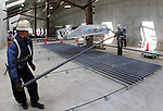 """September 6, 2016, Ichikawa, Japan - Construction workers of Japan's Shimizu Corporation demonstrate for the operation of a robot arm to assist workers to carry a heavy steel bar, 13m in length and weighing 200kg at a construction site of Gaikan highway in Ichikawa, suburban Tokyo on Tuesday, September 6, 2016. Shimizu and ActiveLink, a subsidiary of japanese electronics giant Panasonic developed a robot arm """"Haikin Assist Robo"""" to carry heavy materials to reduce workload of construction workers.    (Photo by Yoshio Tsunoda/AFLO) LWX -ytd-"""