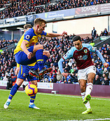 2nd February 2019, Turf Moor, Burnley, England; EPL Premier League football, Burnley versus Southampton; James Ward-Prowse of Southampton jumps over a cross from Dwight McNeil of Burnley