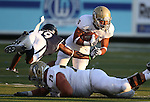 Nevada defender Evan Favors dives past UC Davis lineman Jimmy Kunkel at running back Tavior Mowry during the first half of a college football game in Reno, Nev., on Saturday, Sept. 7, 2013. (AP Photo/Cathleen Allison)