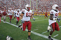 6 October 2007: Chris Marinelli, Chijoke Amajoyi, Alex Fletcher and Levirt Griffin run out after halftime during Stanford's 24-23 win over the #1 ranked USC Trojans in the Los Angeles Coliseum in Los Angeles, CA.