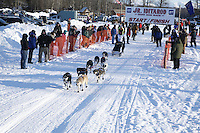 Saturday, February 24th, Knik, Alaska.  Jr. Iditarod musher Gerald Atwater leaves start line on Knik Lake