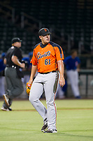 AZL Giants relief pitcher Sidney Duprey (61) walks off the field between innings of the game against the AZL Cubs on September 6, 2017 at Sloan Park in Mesa, Arizona. AZL Giants defeated the AZL Cubs 6-5 to even up the Arizona League Championship Series at one game a piece. (Zachary Lucy/Four Seam Images)