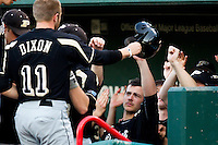 Andrew Dixon (11) of the Purdue Boilermakers is congratulated by teammates after scoring during a game against the Missouri State Bears at Hammons Field on March 13, 2012 in Springfield, Missouri. (David Welker / Four Seam Images)