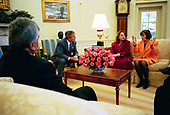 United States President George W. Bush listens to Dr. Katrin Michael, at right, Della Jaff and Idres Hawarry in the Oval Office Friday, March 14, 2003. The three are from the Kurdish area of Iraq where a chemical weapons attack killed 5,000 citizens 15 years ago this weekend. Thousands died in the days following the attack on Halabja and an estimated 10,000 people still suffer from the attack. Idres Hawarry survived the attack on Halabja, Dr. Michael survived a similar attack in another Kurdish village and friends and family of Della Jaff were killed in Halabja.<br /> Mandatory Credit: Eric Draper / White House via CNP