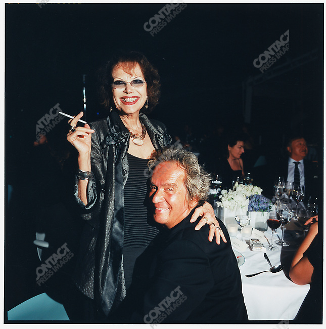 Claudia Cardinale (left) and Albert Koski, photographed at the annual party hosted by Vanity Fair magazine during the Cannes Film festival, held at the Hotel du Cap's Eden Roc restaurant. Cannes, France, May 20, 2007.