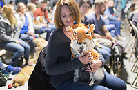 NWA Democrat-Gazette/CHARLIE KAIJO Amy Cotham of Rogers holds her dog Lily, dressed as a giraffe, during a dog show, Saturday, April 21, 2018 at the Rogers Farmer's Market in Rogers.<br />