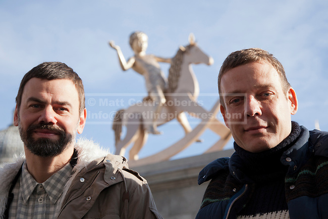 23/02/2012. LONDON, UK. Artists  Ingar Dragset (L) and Micheal Elmgreen (R) pose after the  unveiling of Trafalgar Square's newest addition. Unveiled by actress Joanna Lumey today (23/02/12) in Trafalgar Square, Elmgreen and Dragset's 'Powerless Structures, Fig. 101' replaces the previous sculpture of a ship in a bottle on the famous Fourth Plinth. Photo credit: Matt Cetti-Roberts