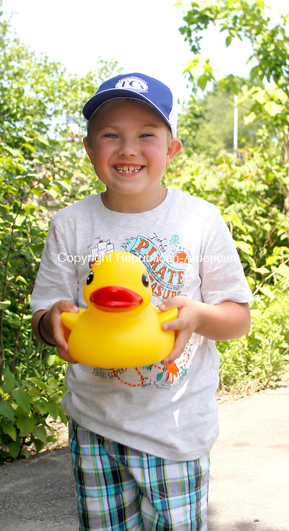 NAUGATUCK, CT.- 01 JUNE 2014 - 060114JW05 - Connor Gliszczynski age 7 shows off the large duck he won by expertly making two throws in the ball toss Sunday afternoon during the Naugatuck Duck Race.<br /> Jonathan Wilcox Republican-American