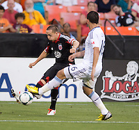 Casey Townsend (16) of D.C. United tries to cross the ball past Johnny Leveron (16) of the Vancouver Whitecaps during a Major League Soccer match at RFK Stadium in Washington, DC. D.C. United lost to the Vancouver Whitecaps, 1-0.