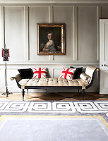 The spacious entrance hall of David Carter's Georgian town house elegantly juggles traditional 18th century architecture with Oriental elements