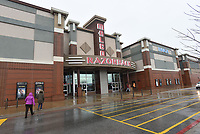 NWA Democrat-Gazette/FLIP PUTTHOFF<br /> Movie patrons enter Malco Razorback Cinema Feb. 24 2018 in Fayetteville. Movie theaters are adding amenities including new concession items and more comfortable seating