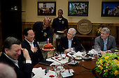 A chocolate cake is presented to Prime Minister Yoshihiko Noda of Japan to celebrate his May 20 birthday, during a G8 Summit working dinner in Laurel Cabin at Camp David, Maryland, May 18, 2012. Seated, from left, are José Manuel Barroso, President of the European Commission, Prime Minister Mario Monti of Italy, and Prime Minister Stephen Harper of Canada..Mandatory Credit: Pete Souza - White House via CNP