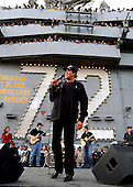 Wayne Newton entertains the officers and crew at sea aboard USS Abraham Lincoln (CVN 72) during a concert held on the ship's flight deck on November 26, 2002.  The show, introduced by General Tommy Franks, Commander, United States Central Command, also included comedian Paul Rodriguez, country singer Neal McCoy and cheerleaders from the Dallas Cowboys. Abraham Lincoln is currently deployed on a scheduled six-month deployment conducting combat missions in support of Operation Southern Watch..Mandatory Credit: Tyler Clements / U.S. Navy via CNP