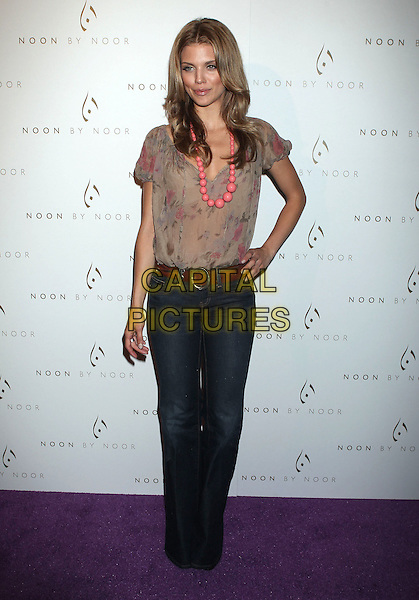 AnnaLynne McCord.'Noon by Noor' Launch Event held at the Sunset Tower Hotel, West Hollywood, California, USA..July 20th, 2011.full length beige pink floral print dress jeans denim wide leg flared hand on hip beads necklace .CAP/ADM/RE.©Russ Elliot/AdMedia/Capital Pictures.