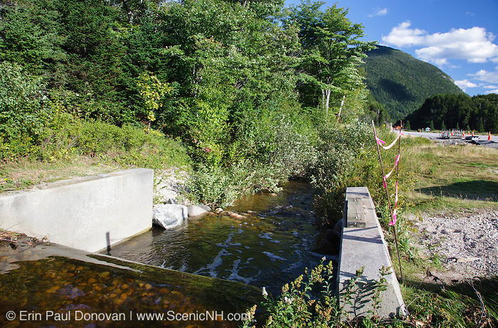 Storm damage from Tropical Storm Irene along Route 302 near the start of Crawford Notch State Park in the White Mountains, NH.During the storm, the wooden bridge that crossed this small dam was torn off its support and dragged down stream. It can be seen in the background. This tropical storm caused destruction along the East Coast of the United States.