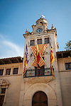 Town Hall of the ancient walled city of Alcudia, Mallorca..Mallorca flags