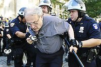 A man is arrested at the New York Public Library in New York City on August 31, 2004 during the Republican National Convention.  The library steps were a meeting point for a group calling itself the A31 Action Coalition which called for civil disobedience on a mass scale that day.  The library steps quickly cleared as police began arresting people, sometimes indiscriminately.
