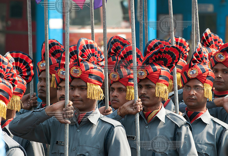Soldiers march with flags on Founders Day in Jamshedpur.