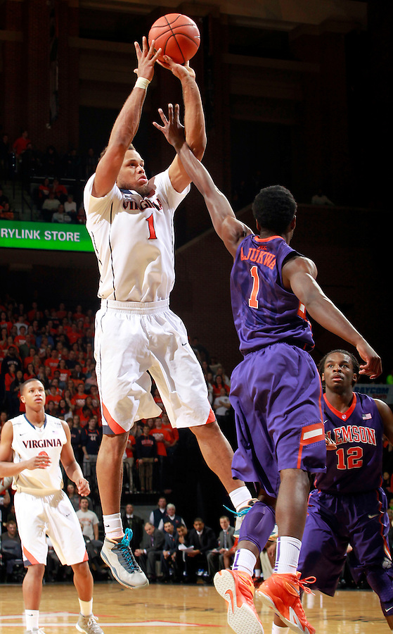 Virginia guard Justin Anderson (1) shoots over Clemson guard/forward Austin Ajukwa (1) during an ACC basketball game Jan. 13, 2015 in Charlottesville, VA Virginia won 65-42.