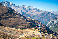 Julia Bleasedale trail running in fall colors above Berguns, Switzerland