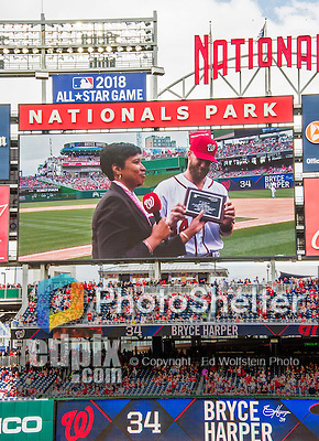 7 April 2016: The Washington Nationals scoreboard screen shows outfielder Bryce Harper accepting the Key to the City from Washington Mayor Muriel Bowser prior to the Nationals' Home Opening Game against the Miami Marlins at Nationals Park in Washington, DC. The Marlins defeated the Nationals 6-4 in their first meeting of the 2016 MLB season. Mandatory Credit: Ed Wolfstein Photo *** RAW (NEF) Image File Available ***
