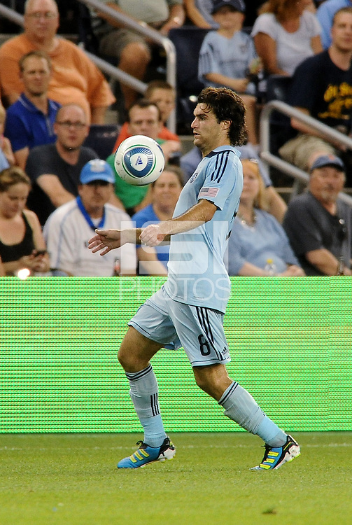 Graham Zusi Sporting KC midfielder controls the ball... Sporting KC defeated Vancouver Whitecaps 2-1 at LIVESTRONG Sporting Park, Kansas City, Kanas.