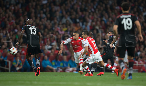 27.08.2014.  London, England. Champions League Qualifying 2nd Leg. Arsenal versus Besiktas. Arsenal's Alex Oxlade-Chamberlain and Alexis Sánchez chase down the loose ball.