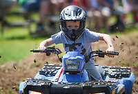 NWA Democrat-Gazette/CHARLIE KAIJO Carter Guyll, 7, of Exeter, MO rides during the Mudtown Days event, Saturday, June 8, 2019 at Ward Nail Park in Lowell. <br />