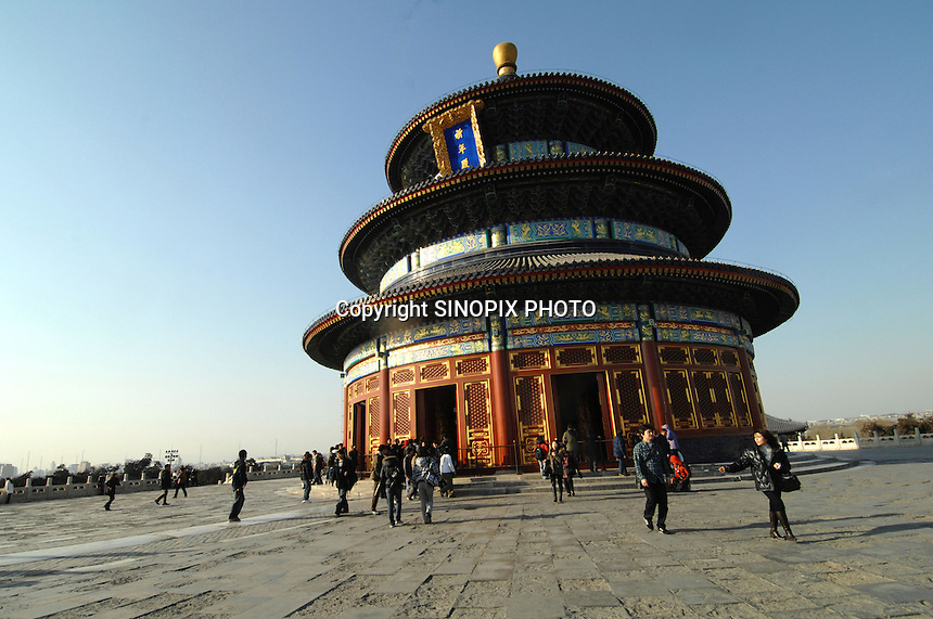 Tourists at The Temple of Heaven complex in Beijing, China. The Temlpe of Heaven is one of the best known and visited tourists attractions in the olympic capital..