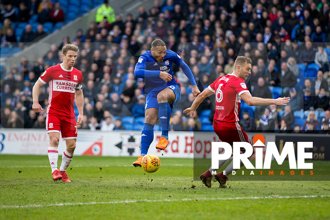 Kenneth Zohore of Cardiff City scuffs a shot at goal under pressure from Grant Leadbitter and Ben Gibson of Middlesbrough during the Sky Bet Championship match between Cardiff City and Middlesbrough at the Cardiff City Stadium, Cardiff, Wales on 17 February 2018. Photo by Mark Hawkins / PRiME Media Images.