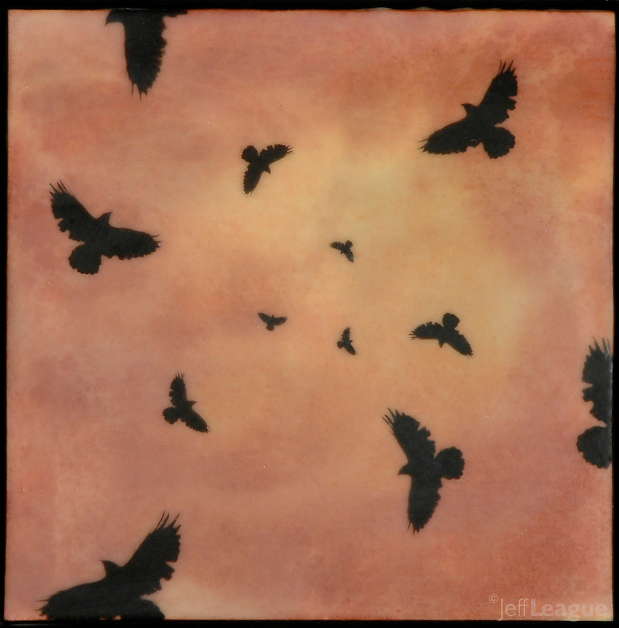 Encaustic painting with photo transfer of murder of crows in black on orange red sky