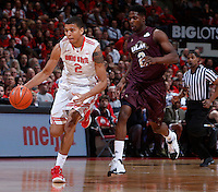 Ohio State Buckeyes forward Marc Loving (2) is pursued by Louisiana-Monroe Warhawks forward DeMondre Harvey (2) during Friday's NCAA Division I basketball game at Value City Arena in Columbus on December 27, 2013. Ohio State won the game 71-31. (Barbara J. Perenic/The Columbus Dispatch)