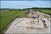 BNPS.co.uk (01202 558833) <br /> Pic: BournemouthUniversity/BNPS<br /> <br /> Winterbourne Kingston Archaelogical dig site.<br /> <br /> <br /> A group of first year university students have made one of the most significant archeological finds of recent times after discovering the 1,700-year-old remains of a wealthy Roman family.<br /> <br /> The budding archaeologists discovered a grave containing five super-rich Romans in a farmer's field in rural Dorset just metres from where a 4th century villa was found.<br /> <br /> Although more than 700 Roman villas have been found in Britain, it is the first time ever the people who lived in them have been uncovered.<br /> <br /> Experts have described the find as &quot;hugely significant&quot; - and say it could provide vital clues to who was living in Britain around 350 AD.<br /> <br /> Around 85 students, mostly aged in their late teens and early 20s, made the landmark discovery after carrying out a study on a corn field near Winterbourne Kingston near Blandford in Dorset.