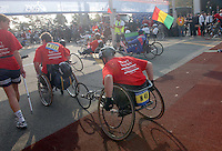 (031102-SWR064.jpg) Staten Island, New York -- 2 Nov 03 - The Wheelchair Division leaves the starting line on the Staten Island Side of the Verazzano Bridge for the start of the New York City Marathon.
