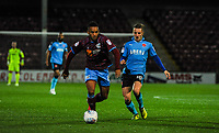 Scunthorpe Utd's midfielder Funso Ojo (6) beats Fleetwood Town's midfielder George Glendon (18) to the ball during the Sky Bet League 1 match between Scunthorpe United and Fleetwood Town at Glanford Park, Scunthorpe, England on 17 October 2017. Photo by Stephen Buckley/PRiME Media Images