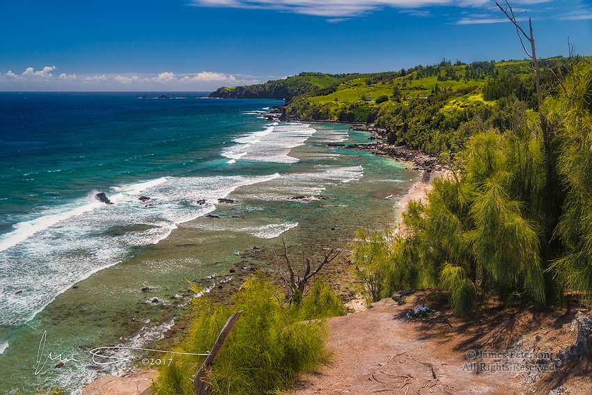 Beach near Kapalua, Maui, Hawaii ©2017 James D Peterson.  This slightly rocky beach is on the northwest corner of Maui.  Beautiful beaches are scattered throughout the Hawaiian Islands, but few are as deserted as this one (though there are actually a couple of tiny, barely visible surfers in the water in this image).