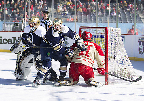 February 17, 2013:  Notre Dame center T.J. Tynan (18) and Miami forward Riley Barber (11) battle in front of Notre Dame goaltender Steven Summerhays (1) during NCAA Hockey game action between the Notre Dame Fighting Irish and the Miami Redhawks at Soldier Field in Chicago, Illinois.  Notre Dame defeated Miami 2-1.