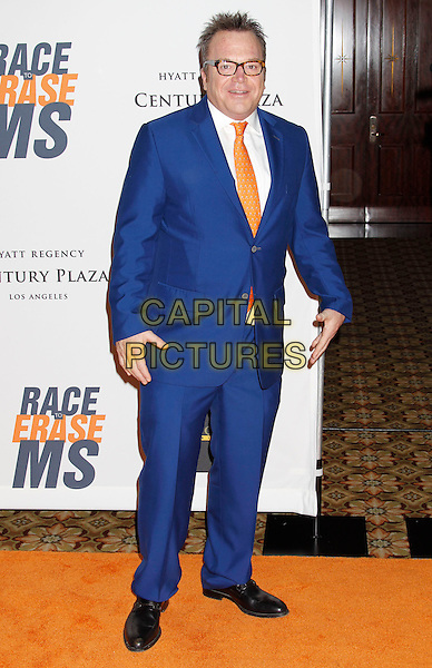 TOM ARNOLD .17th Annual Race To Erase MS. Held at the Hyatt Regency Century Plaza Hotel,   Century City, California, USA, .May 7th 2010..full length blue suit glasses orange tie .CAP/ADM/MJ.©Michael Jade/AdMedia/Capital Pictures.