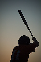 Youth baseball player stands in the batters box ready for the next pitch in one of the final games of the season.