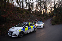 Pictured: Police at the entrance to the lane leading to the house that was burned in a fire in Llangammarch Wells, Wales, UK. Tuesday 07 November 2017<br /> Re: Dyfed Powys Police press conference at Llandrindod Wells over a house fire that killed a father and his children in Llangammarch Wells, mid Wales, UK. <br /> David Cuthbertson, 68, and the children aged between four and 11 are missing, presumed dead, following the blaze.<br /> Three other children aged 10, 12 and 13 escaped and were taken to hospital.<br /> Dyfed-Powys Police said they have been released and are being cared for by family.