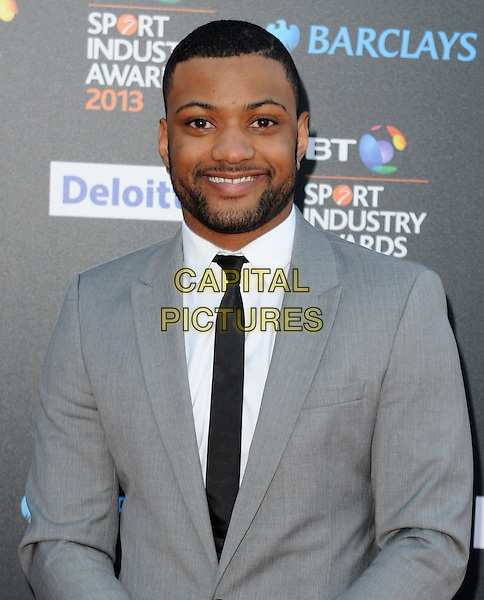 Jonathan 'JB' Gill of JLS.Attending the BT Sport Industry Awards at Battersea Evolution, London, England, UK, May 2nd 2013..half length smiling beard facial hair grey gray suit   .CAP/PP/GM.©Gary Mitchell/PP/Capital Pictures