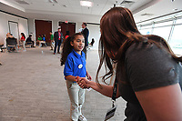 NWA Democrat-Gazette/J.T. WAMPLER Alessandra Joya shakes hands with Kelly Johnson during the Amazing Shake Thursday April 11, 2019 at the Jones Center in Springdale. Students from Jones Elementary, Parson Elementary, and Grace Hill Elementary in Rogers competed to be named Amazing Shake champion. The Amazing Shake places an emphasis on teaching students leadership, manners, discipline, respect and professional conduct. Prior to the competition, students learn the nuances of professional human interaction as they are taught skills such as how to give a proper handshake, how to Òwork a room,Ó how to give a successful interview, and how to remain composed under pressure.