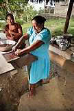 BELIZE, Punta Gorda, Village of San Pedro Colombia, grinding Cacao beans into chocolate