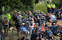 Fans chat with Police on the embankment during the One Day International cricket match between the NZ Black Caps and Pakistan at the Basin Reserve in Wellington, New Zealand on Saturday, 6 January 2018. Photo: Dave Lintott / lintottphoto.co.nz