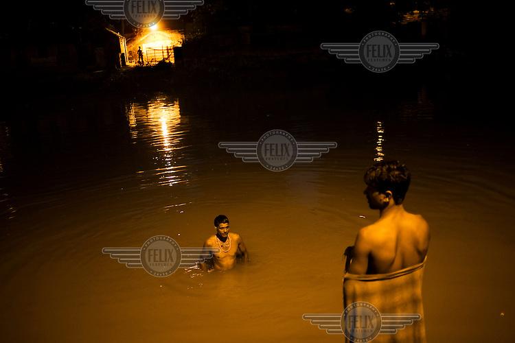 Men wash in a canal in Calcutta.