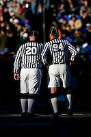 A pair of referees wait at midfield for a time-out to end during the Face-Off Classic in at M&T Stadium in Baltimore, MD