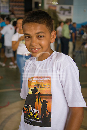 "Altamira, Brazil. ""Xingu Vivo Para Sempre"" protest meeting about the proposed Belo Monte hydroeletric dam and other dams on the Xingu river and its tributaries. A non-Indian boy with Xingu Alive forever t-shirt."
