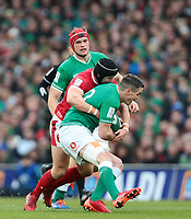 8th February 2020; Aviva Stadium, Dublin, Leinster, Ireland; International Six Nations Rugby, Ireland versus Wales; Leigh Halfpenny (Wales) tackles Jonathan Sexton (Captain Ireland)